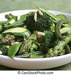 Sauteed green vegetables, topped with almonds. Delicious, nutritious eating.