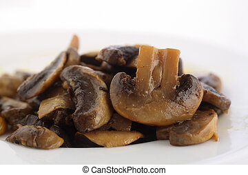 Sauteed mushrooms on plate - A side view of sauteed...