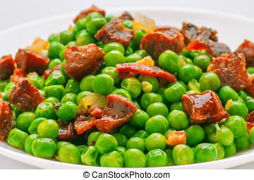 sauteed pea dish with ham and chorizo