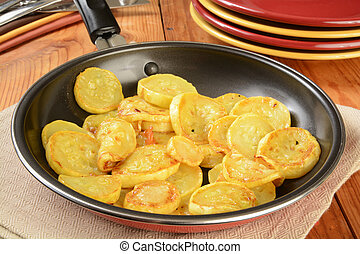 Sauteed squash - Sauteed summer squash in a frying pan with...