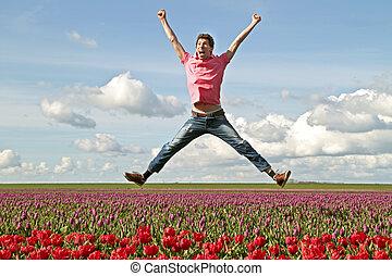 sauter, enthousiaste, haut, jeune, champs, tulipe, type