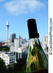 Sauvignon Blanc bottle against Auckland skyline - Selective...
