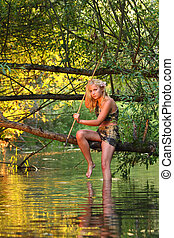 savage girl - cute savage girl with gaff sits on a branch...