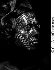 Savage religious woman voodoo with ornamental tattoo. Tribe person. Painted face