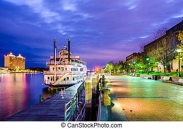Savannah, Georgia, USA riverfront promenade at twilight.