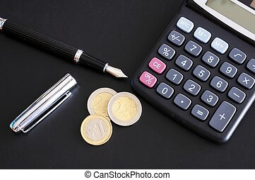 save money concept with calculator and euro money coins on...