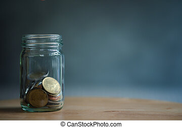 Save money for investment concept coin baht thai in the glass jar