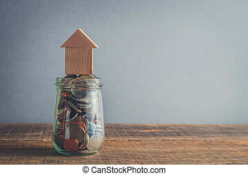 save money for investment mortgage concept by money house from a coins with filter effect retro vintage style