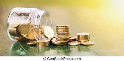 Save money - gold coins with a jar glass