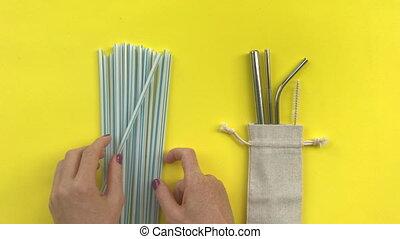 Save planet. Plastic straws vs metal reusable. Shot on a ...