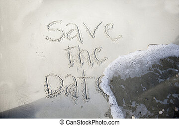 save the date, in sand - save the date, written in sand and...