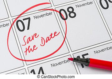 Save the Date written on a calendar - November 7