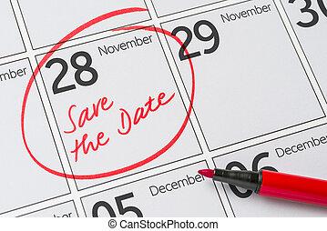 Save the Date written on a calendar - November 28