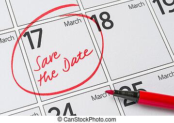 Save the Date written on a calendar - March 17
