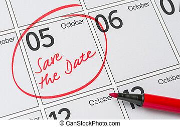 Save the Date written on a calendar - October 5