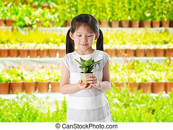 Save the environment - Concept of little girl holding a ...