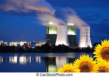 save the nature concept with sunflower and oil power plant