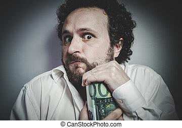 Saver, man with intense expression, white shirt
