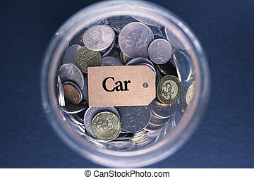 Saving Concept : Car label with coins in the glass