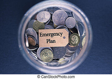 Saving Concept : Emergency Plan  label with coins in the glass