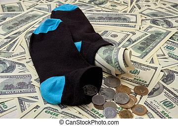 Saving dollars money in socks.