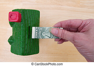 Saving for a down payment of your house, A piggy bank in the shape of a house and add a dollar bill to it