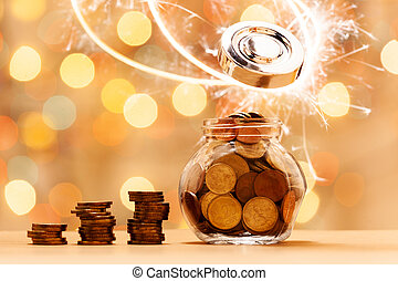 Coin in glass jar with money stack step up growing growth saving money.