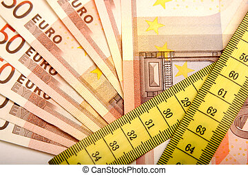 Saving Money - Digital photo of money and a tapeline that...