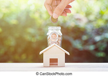 Saving money, home loan, mortgage, a property investment for future concept.