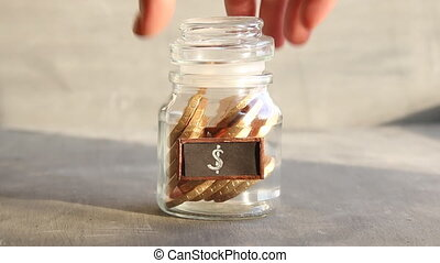 Saving money jar. Golden coins and tag.