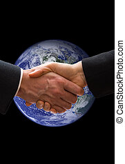 Saving our planet - hand shake with the earth in the...