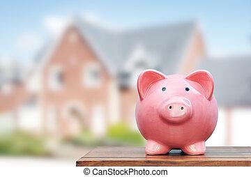 Saving to buy a house, real estate or home savings, piggy...