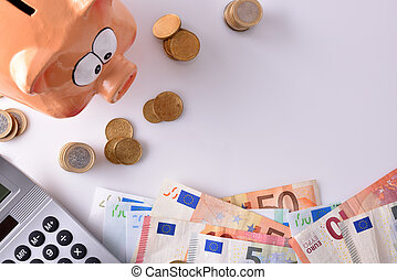 Savings and accounting with piggy bank money and calculator top