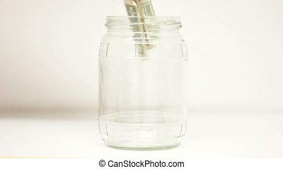 Savings Euros with Dollars in jar