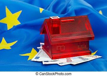 Savings for a new home - Miniature home with euros on an EU...