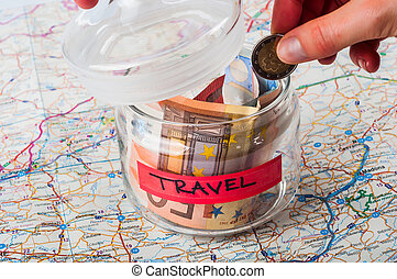 Savings jar for travel on a map