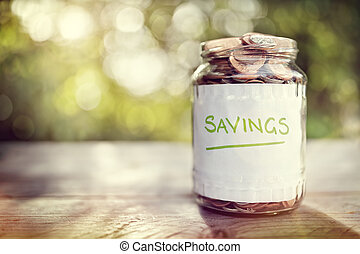 Savings money jar full of coins concept for saving or...