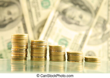 Savings - Row of coins on the background of dollars