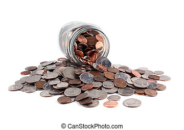 Savings - U.S. coins spilled from a jar on a solid white ...