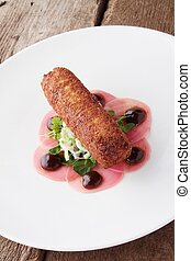 savory croquette plated appetizer