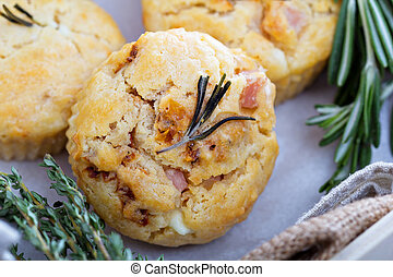 Savory muffins with herbs, tomatoes and ham