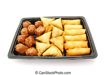 A black plastic plate with traditional South African savoury party food: delicious curry meatballs, samosas and spring rolls. Image isolated on white studio background.