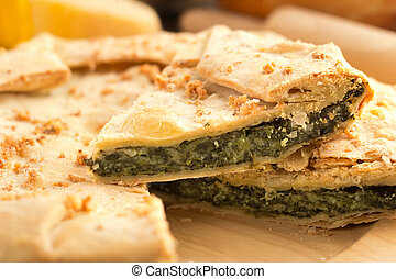 savory pie - close up of a slice of spinach pie