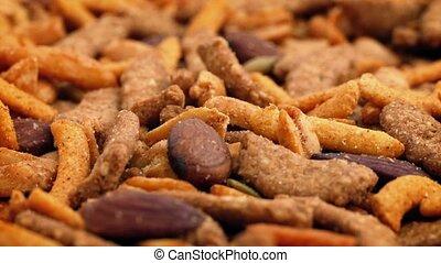 Closeup of tasty savory snack mix turning slowly