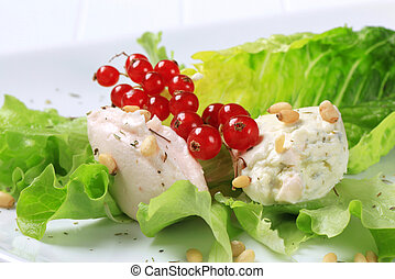 Savory spreads on lettuce leaves sprinkled with pine nuts