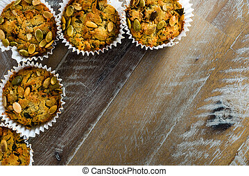 Handmade Savoury Blue Cheese Cupcakes on vintage wooden background, aerial top view, available copy space on the right