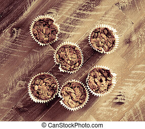 Handmade Savoury Blue Cheese Cupcakes on vintage wooden background, aerial top view, toned filter applied