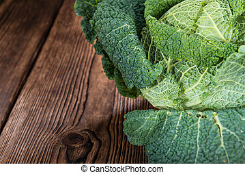 Savoy Cabbage (close-up shot) on wooden background