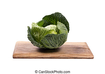 Savoy Cabbage on a wooden board in white background