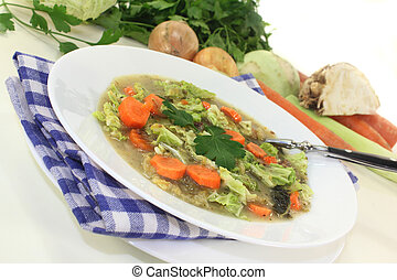 a white plate with savoy cabbage stew